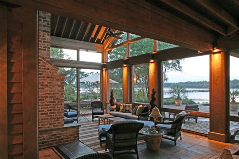 screened porch with fireplace glass uppers protect outdoor fireplace on screened porch