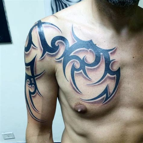 Tribal Chest And Arm Tattoo Designs