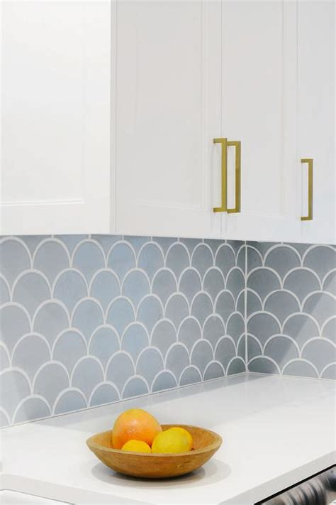 carrera marble fan shaped fish scale tile backsplash