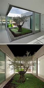 This Island House Has A Large Landscaped Terraced Garden And An Atrium With A Single Olive Tree