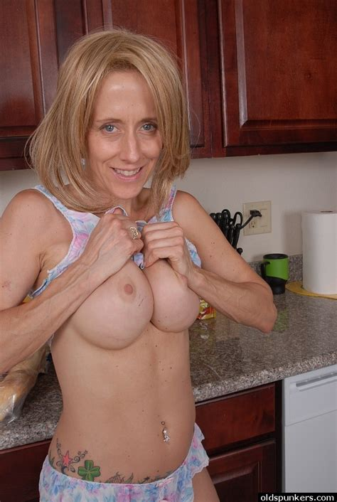 Over 40 Milf Charlotte Exposing Large Tits And Tattoos In