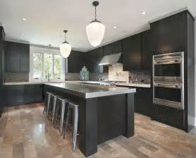 dark cabinets grey countertops and light wood floors
