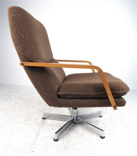 mid century modern style swivel lounge chair with ottoman