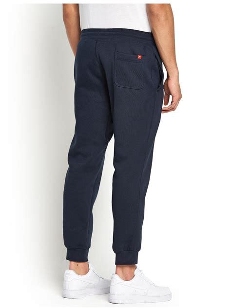cuffed sweatpants for nike aw77 mens cuffed fleece in blue for navy