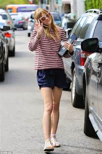 Pregnant Jaime King shows off her lean legs in navy shorts ...