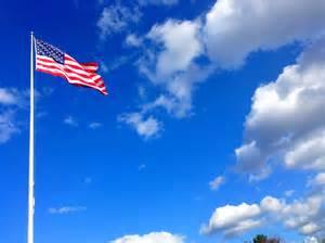 American Flag Waving Blue Sky Clouds