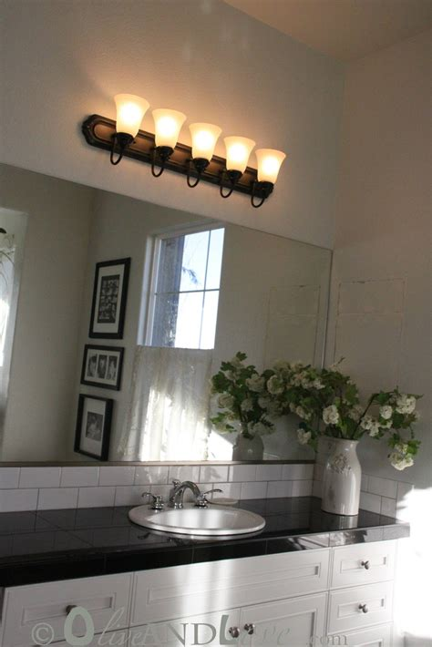 spray painting light fixtures olive and love spray painting bathroom light fixture