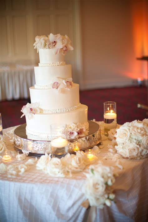 white wedding cake  flowers  silver stand