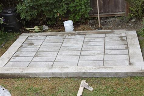 diy modern shed concrete perimeter  paving stone floor