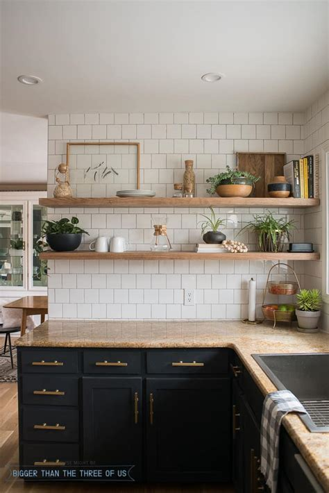 Kitchen Reveal with Dark Cabinets and Open Shelving
