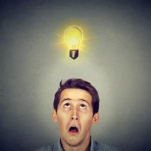Man With Amazed Face Expression Light Bulb Over Head Stock Photo