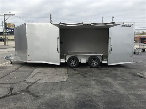 enclosed car hauler trailer  tapered  nose silver