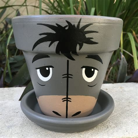 protection pot de fleur eeyore inspired painted flower pot