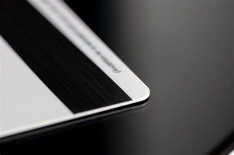 Hold your device near the card reader to open apple. Premium Photo | Close up credit banking card. privacy card ...