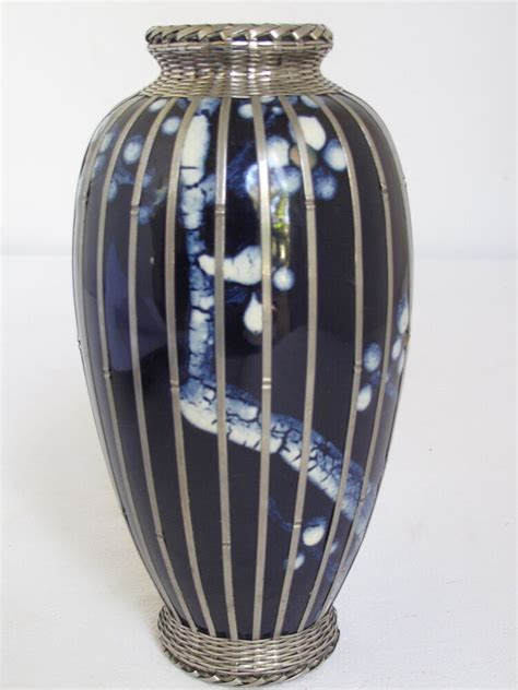 japanese meiji pottery vase with silver basket weave