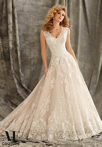 Embroidered appliques on tulle ball dress with wide for Embroidered wedding dress