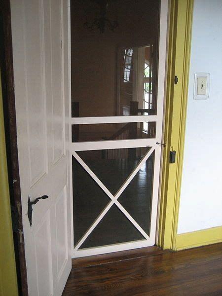 interior screen door  guest room    cats