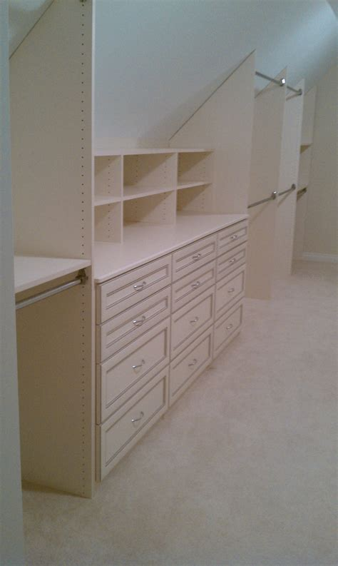 antique white slanted ceiling closet clever closets inc