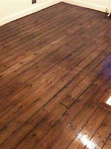 Pine floorboards after floor sanding staining with dark for Pine floors stained dark