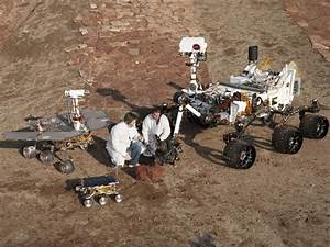 NASA - Three Generations of Rovers with Crouching Engineers