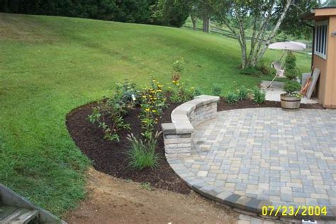 raised paver patio sitting wall landscaping ciminelli s