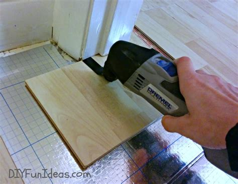 how to cut laminate flooring around doors how to install beautiful laminate floors in one afternoon do it yourself fun ideas