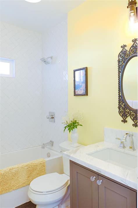 Modern Yellow Bathroom Decor by A Coffee Colored Vanity And Mosaic Tile Floor Are An
