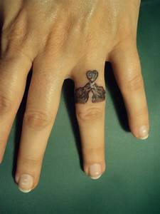 Wedding ring tattoos designs ideas and meaning tattoos for Wedding ring tattoos male