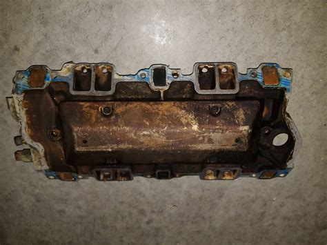 serp tensioner member reply manifold braces intake valve covers