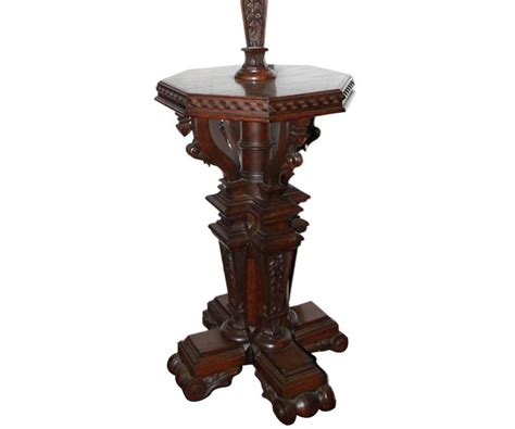 antique gothic revival floor l with attached table at