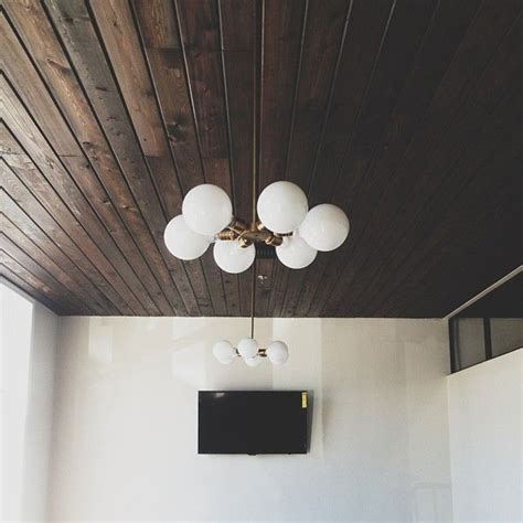 dark wood panels on our vaulted living room ceiling would
