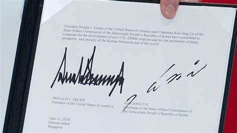 sommet trump kim ce  disent les signatures de leur