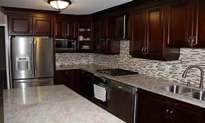 cherry wood kitchen cabinets with black granite - 28