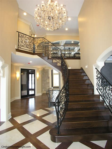 2 story foyer chandelier 2 story foyer with curved iron railings and wooden