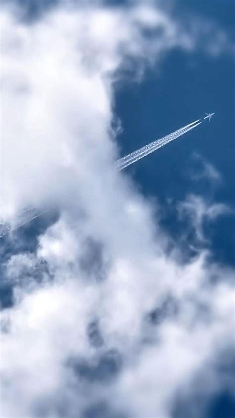 flying airplane smoke trail clouds android wallpaper