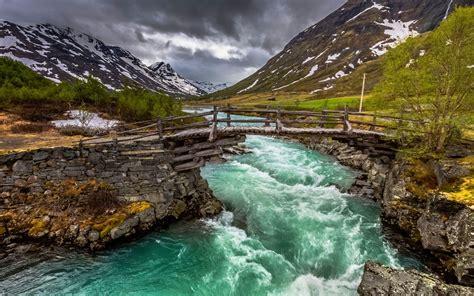 nature blue river water bridge stone  timber mountain
