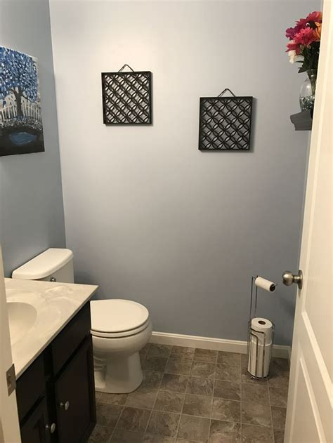 our powder room sherwin williams honest blue paint in a small bathroom with no windows looks