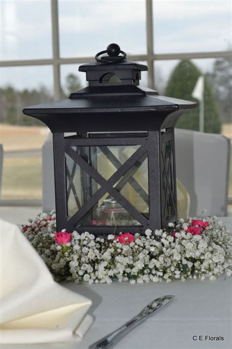 Lantern decorated with baby's breath and pink flowers for