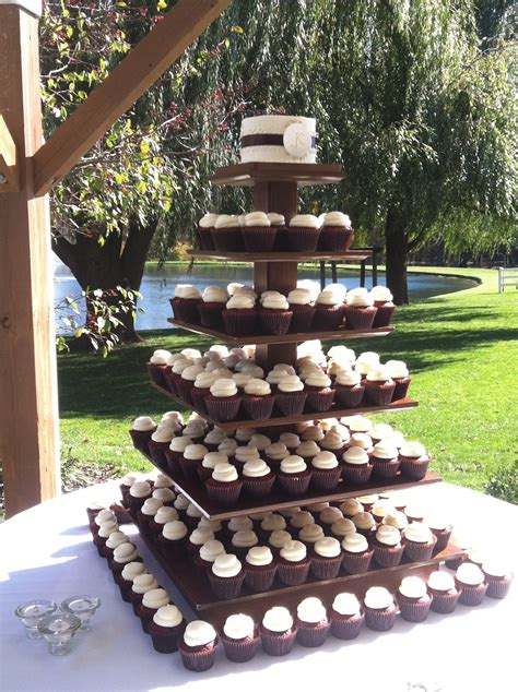 Rustic outdoor Wedding cake and cupcakes Dessert Display