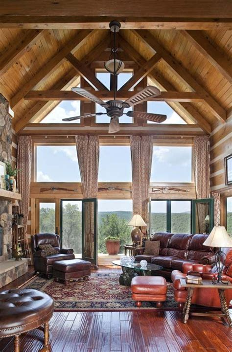 vaulted great room  trusses glass gable loghome