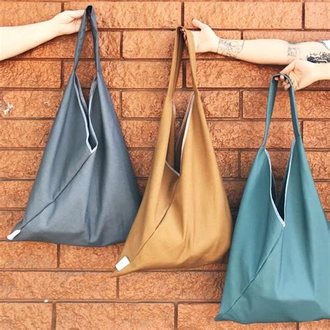market triangle tote solid canvas marleys monsters