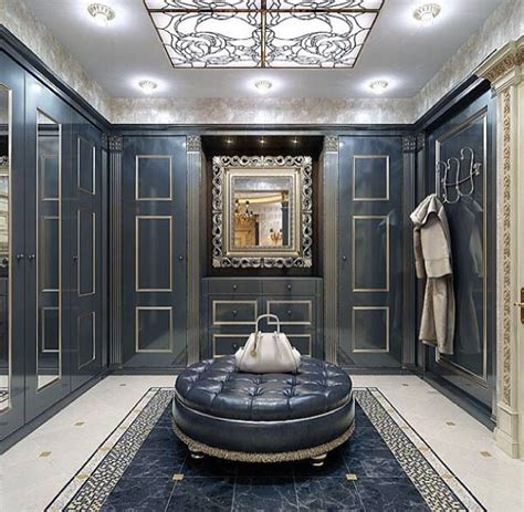 luxury walk in closet with vismara design frame mirror in