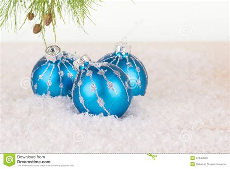 blue christmas baubles and pine tree branch stock photo