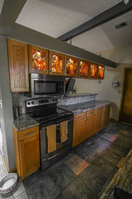 oak kitchen  stained glass inserts traditional