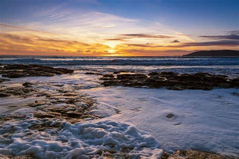 shell beach cliffs frothy waterjpg featured prints