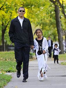 President Barack Obama with daughter, trick or treating ...