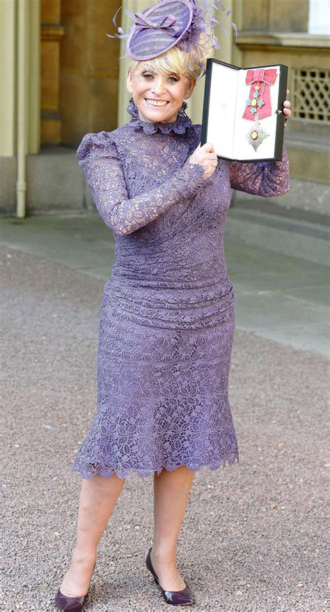 Barbara Windsor beams as she receives damehood from ...