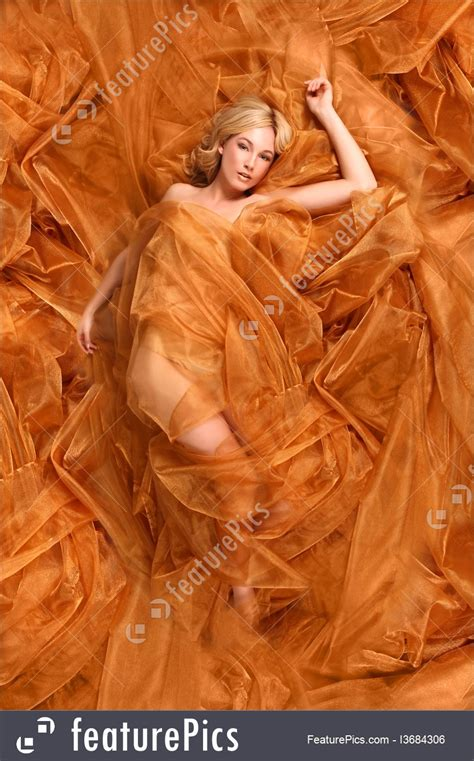 woman wrapped  fabric photo