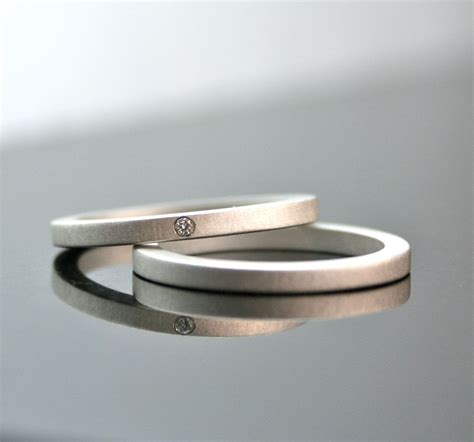 one tiny diamond ring set simple wedding rings by cocoandchia