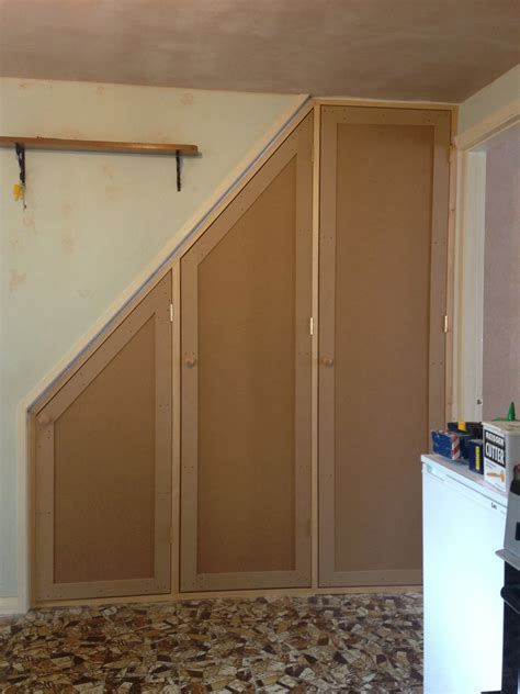 Stairs Cupboard by Fitted Shelving Cupboards And Flooring P D Carpentry